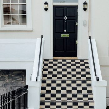 checkered steps leading to entry door