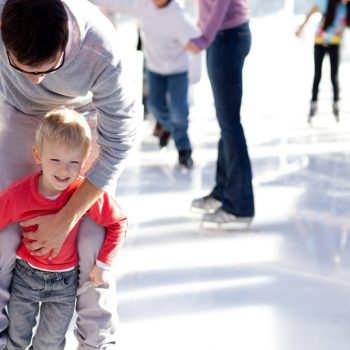 family skating at ice rink