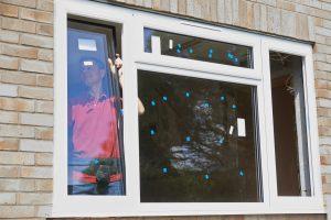 guy installing window
