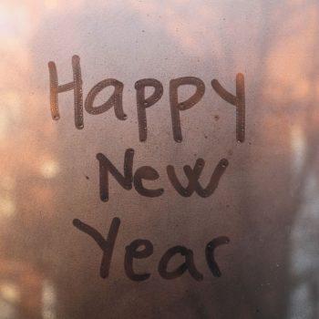 happy new year written on window
