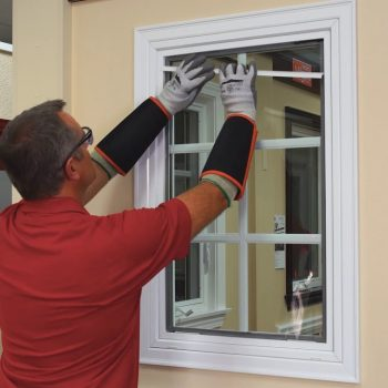 guy replaces fiberglass window