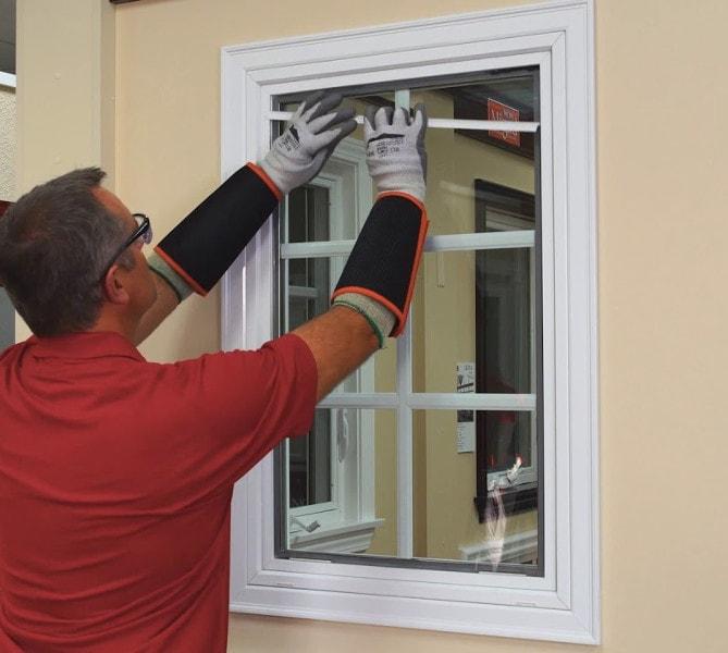 guy replaces fiberglass window